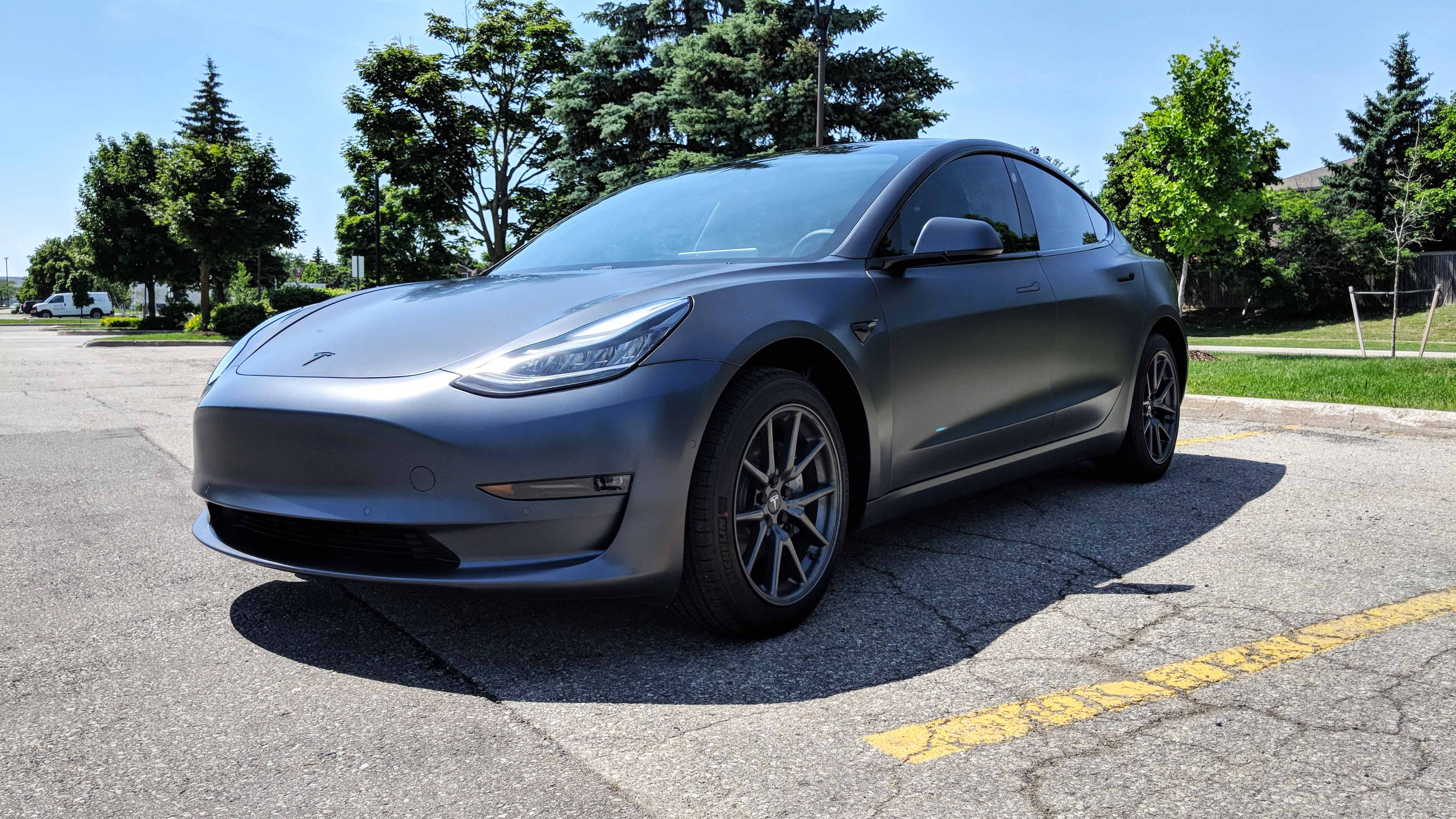 Tesla Model 3 Xpel paint protection film wrap with gloss black chrome delete