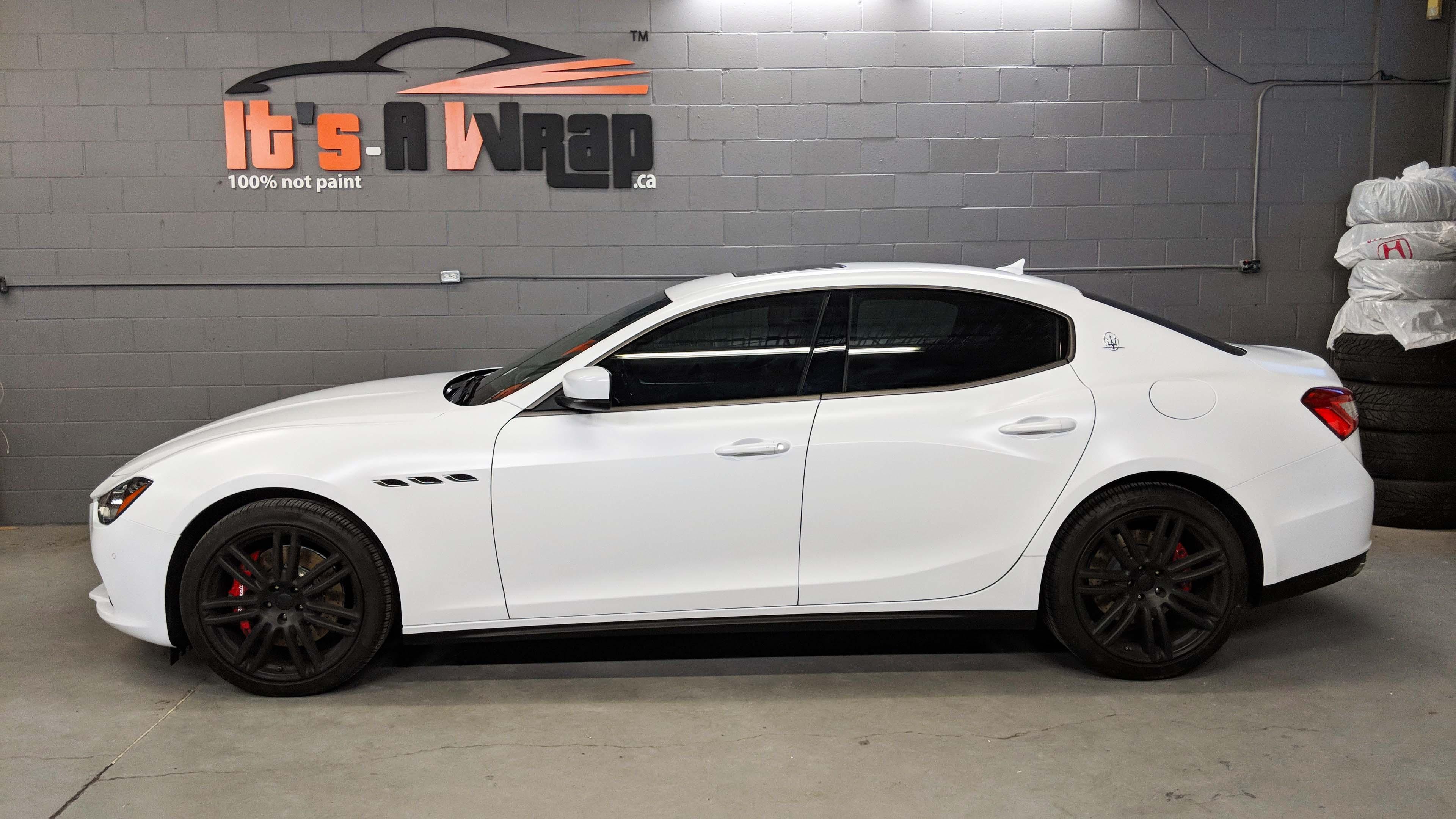 Maserati Ghalib wrap Avery satin white with charcoal chrome delete