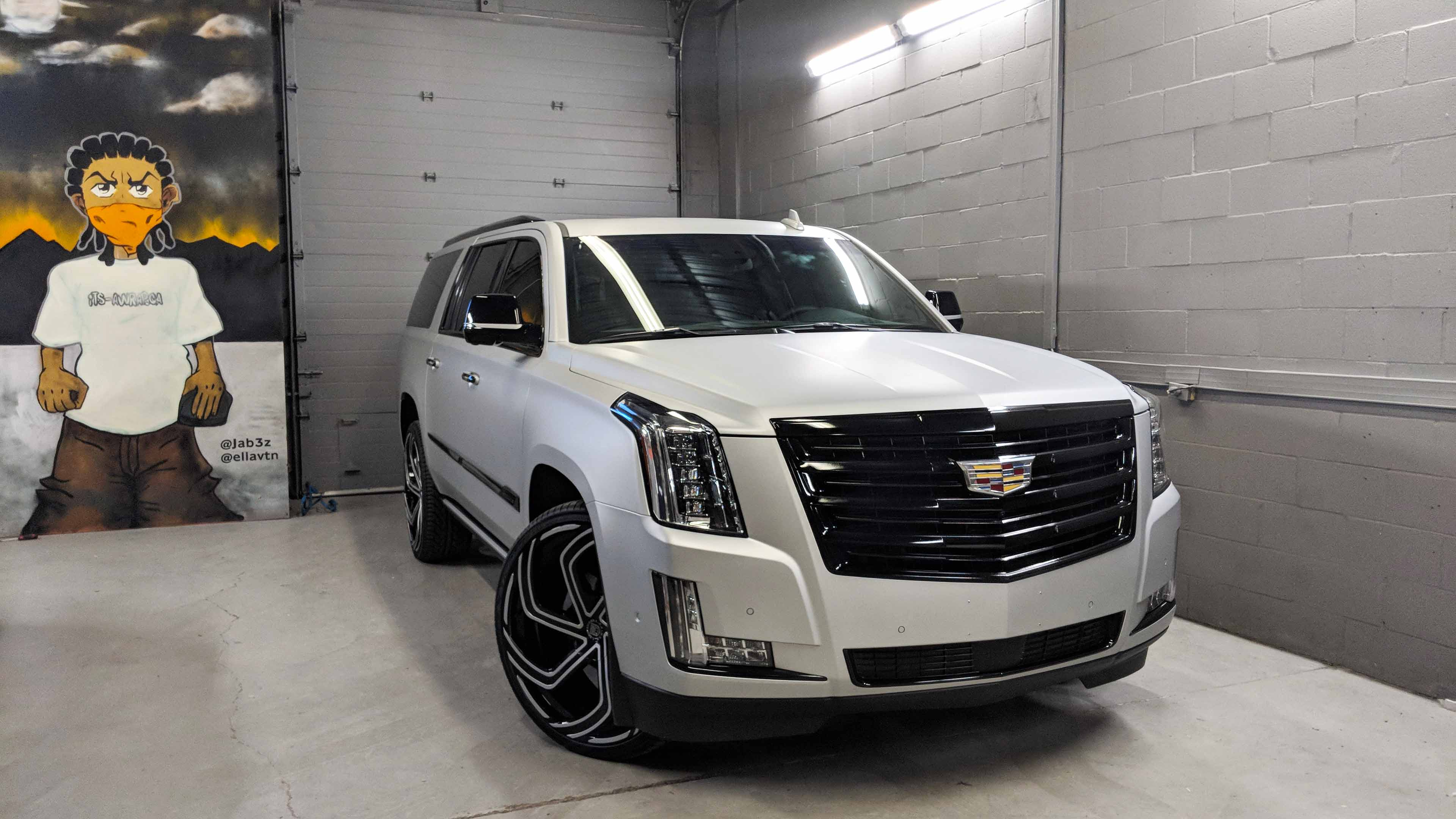 Cadillac Escalade matt aluminum wrap with gloss black chrome delete